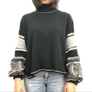 Free People black turtleneck with knit sleeves